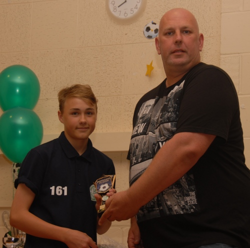 Conan Wyer, who has made a big impression in his short time at the Green, receives the Managers Player award from team rep Mark Smith