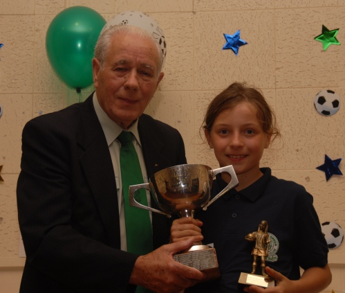 Nicole Baker receives the prestigious Peter Knott Memorial Trophy from Vice President Jack Stafford