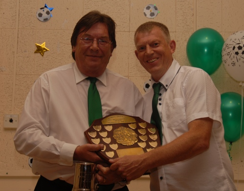 Stan Donald presents Pat Penfold with the Clubman of the Year award