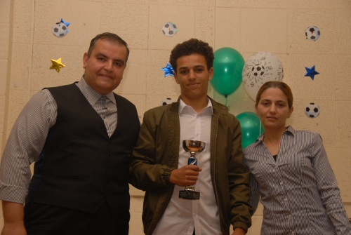 Voted as the Seniors Player of the Season was Levii Loyza, seen here with sponsors Khaled and Nancy of Key Auto Trade
