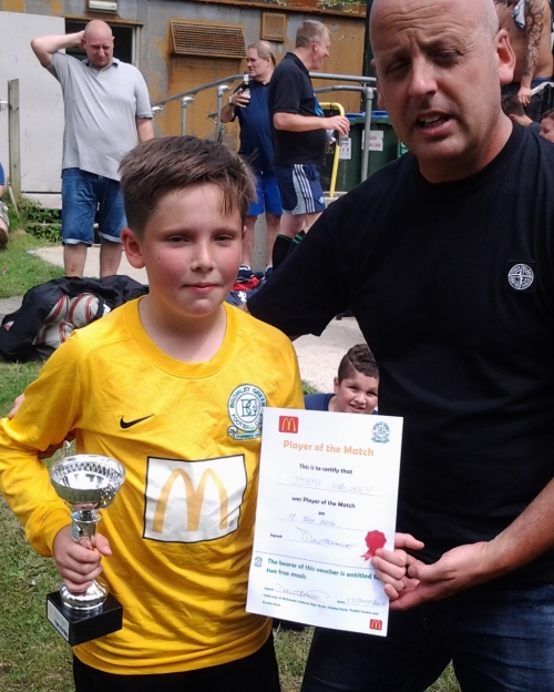 Sid presents Joseph with the McDonalds Player of the Match and voucher for free meals