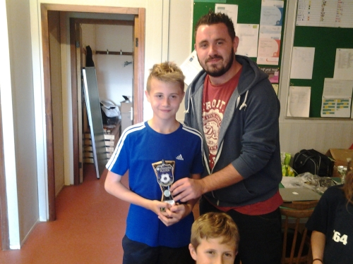 Congratulations Travis who receives his Merit Award from James Porter
