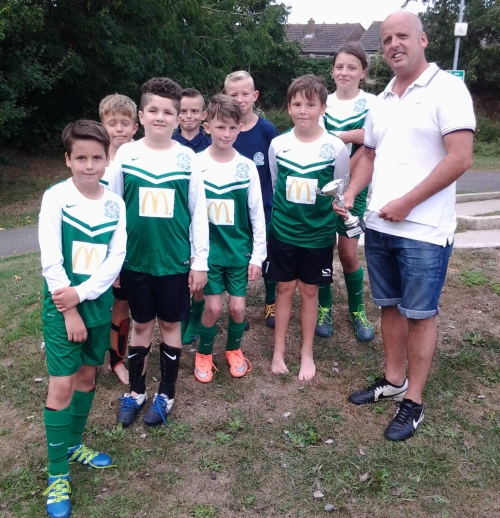 The Green U11s still smiling after their defeat