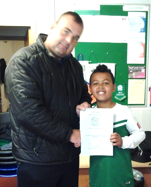 Anton receives his BGFC voucher from Grant after being voted PoM