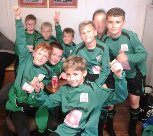 In brilliant form at Waterside on Saturday, the U12s celebrate in the clubhouse