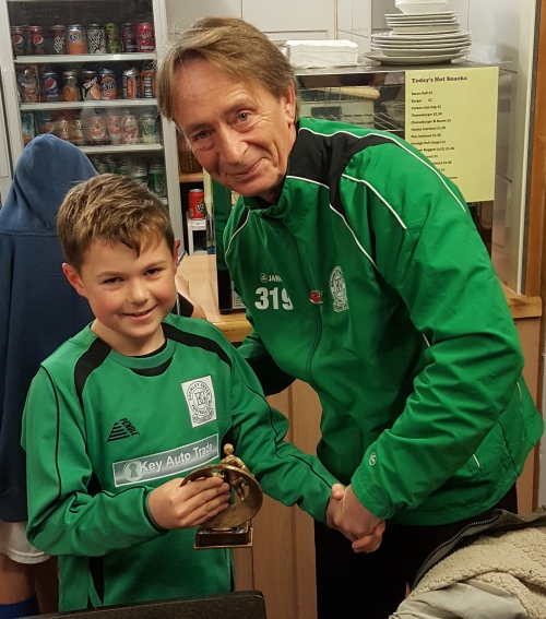 Henry, pictured with Vice President Mark Day, is the Green's Player of the EKYL Festival
